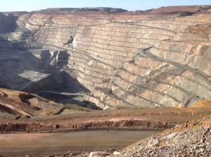 """The """"Superpit"""" at Kalgoorlie Boulder, WA, Aust. The largest open cut goldmine in the world. It takes trucks 45 mins to carry one load from the pit - talk about a long haul!"""